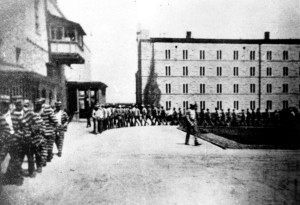 Missouri State Penitentiary inmates march on the grounds circa 1900.