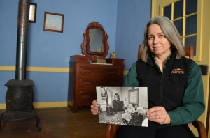 Cindy Browne, administrator of the Deutschheim State Historic Site in Hermann, holds a photo of Rosa Strehly in the home where she lived for 97 years.