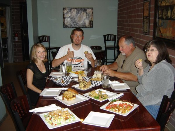 Jeremy Ray, owner of Jray's (seated center) enjoys his work - and his food.